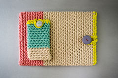Beautiful Crocheted Mobile Phone and Tablet Sleeves Stock Photo