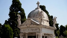 Beautiful crypt in cemetery. Action. Burial structure with dome in cemetery means crypt. European cemetery with white