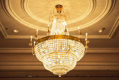 Beautiful crystal chandelier in ball room Stock Photo