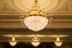 Beautiful crystal chandelier in ball room Stock Image