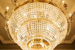 Beautiful crystal chandelier in ball room Stock Photography