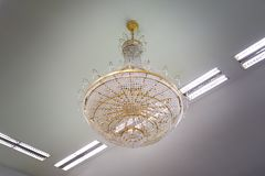 Beautiful crystal chandelier. In a room Royalty Free Stock Image