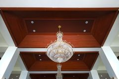 Beautiful crystal chandelier. In a room Royalty Free Stock Photos