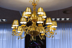 Beautiful crystal chandelier in hotel lobby Royalty Free Stock Image