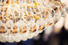 Beautiful crystal chandelier. Jewelry on a crystal chandelier royalty free stock image