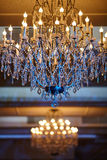 Beautiful crystal chandelier in a room Royalty Free Stock Photo