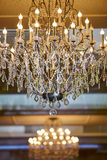 Beautiful crystal chandelier in a room Stock Photos