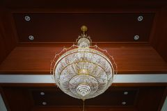 Beautiful crystal chandelier. In a room Stock Photo