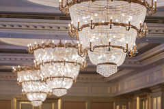 Beautiful crystal chandeliers. At hall royalty free stock image