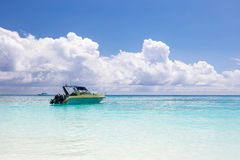 Beautiful crystal clear sea and white sand beach with boat at Tachai island, Andaman Stock Photography