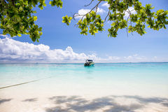 Beautiful crystal clear sea and white sand beach with boat at Tachai island, Andaman Royalty Free Stock Image