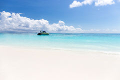 Beautiful crystal clear sea and white sand beach with boat at Tachai island, Andaman Royalty Free Stock Images