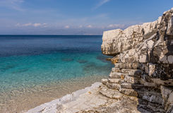 Beautiful crystal clear waters from the beach of Kassiopi, Corfu, Greece.  Stock Photography