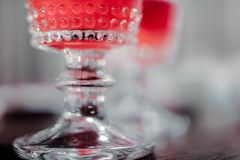 Beautiful crystal drinking glass closeup. Alcohol concept with blurred background stock image