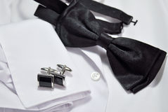 Cufflinks and white shirt Royalty Free Stock Images