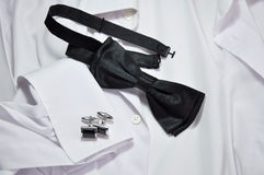 Cufflinks and white shirt Stock Image