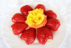 Beautiful cultivated deep red delicious strawberries, macro photography, decoration with fruit in white and rose flower. Beautiful cultivated deep red delicious royalty free stock image