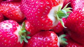 Beautiful cultivated deep red strawberries, macro photography, food and fruit. Delicious stock images