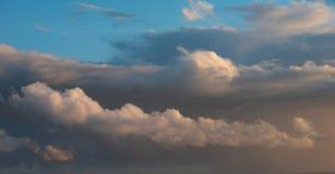 Beautiful cumulonimbus stormy rain cloud formations in Summer su. Stunning cumulonimbus storm and rain cloud formations in Summer sunset sky with dramatic moody Stock Photo