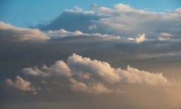 Beautiful cumulonimbus stormy rain cloud formations in Summer su. Stunning cumulonimbus storm and rain cloud formations in Summer sunset sky with dramatic moody Stock Images