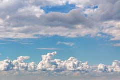 Beautiful cumulus clouds in a blue sky.  stock image