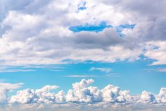 Beautiful cumulus clouds in a blue sky.  royalty free stock photo