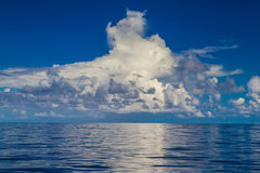 Beautiful cumulus clouds in the horizon above tropical islands in the sea Royalty Free Stock Photos
