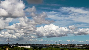 Beautiful Cumulus Clouds over Town Stock Images
