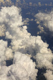Beautiful cumulus clouds in sky above the earth Royalty Free Stock Photo