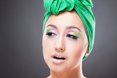Beautiful cunning woman with bright makeup. Beautiful young cunning woman with bright makeup Stock Images