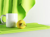 Beautiful cup and an apple on the towel Royalty Free Stock Images