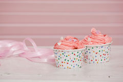 Beautiful cupcake with cream and hearts Stock Images