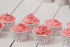 Beautiful cupcake with cream and hearts on white boards backgrou Stock Photography