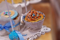 Beautiful cupcake. Small wedding cake with cream and colorful sweets Stock Photo
