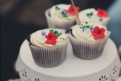 Beautiful cupcakes with berries closeup on banquet table. Royalty Free Stock Photography