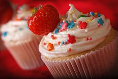 Beautiful cupcakes with cream and strawberries macro. horizontal Royalty Free Stock Image