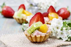 Beautiful cupcakes decorated with fresh fruits Stock Photography