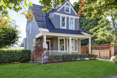 Beautiful curb appeal. American house with well kept front yard. Beautiful curb appeal. American blue house with well kept front yard. Northwest, USA Royalty Free Stock Photo
