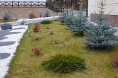 Beautiful curb appeal of a classic holiday home in Siberia with a beautiful front yard landscaping. Image of landscaping. Remarkable decision of the designer stock photos