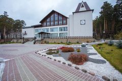 Beautiful curb appeal of a classic holiday home in Siberia with a beautiful front yard landscaping. Image of landscaping. Remarkable decision of the designer stock photo