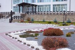 Beautiful curb appeal of a classic holiday home in Siberia with a beautiful front yard landscaping. Image of landscaping. Remarkable decision of the designer stock photography