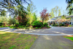 Beautiful curb appeal. Farm house and circle drive way Stock Photography