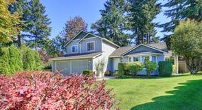 Beautiful curb appeal. Gray siding house on a sunny day Stock Photos