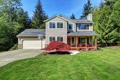 Beautiful curb appeal  of suburban two story house. With well kept lawn and fir trees around the house. Northwest, USA Stock Images