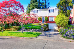 Beautiful curb appeal of two level house with one garage space. Royalty Free Stock Image