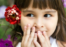 Beautiful curious girl with a flower royalty free stock photo