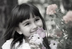 Beautiful curious girl  in a garden Royalty Free Stock Photo