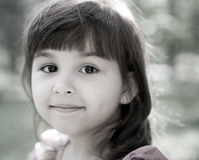 Beautiful curious girl  in a park Royalty Free Stock Photos