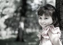 Beautiful curious girl  in a park Royalty Free Stock Photo
