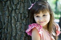 Beautiful curious girl  in a park Stock Photos